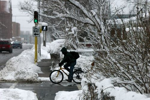 Bicyclist at West 38th Street and Blaisdell Avenue, in the winter