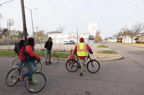 Tim Springer leads bike ride through streets of Detroit.