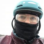 Selfie in helmet, safety glasses, and gaiter. Covered with layer of ice.