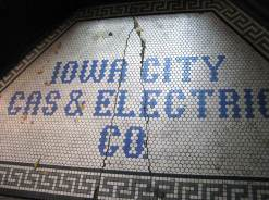 Blue tile letters, Iowa City Gas & Electric Co, white background, Greek toga-style edge