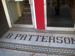 B Patterson tile letters in green, white background, multicolored border with zigzag pattern
