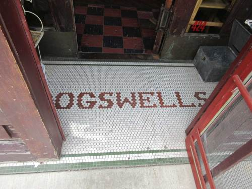 Red tile letters say Ogswells, green border, white background