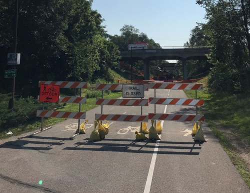 Barricades blocking the construction zone on the Midtown Greenway