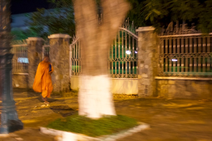 Show monk walking at Night in Cambodia