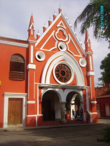 Church in Cartagena combining mudejar arch and pillars with baroque and vibrant colonial colours