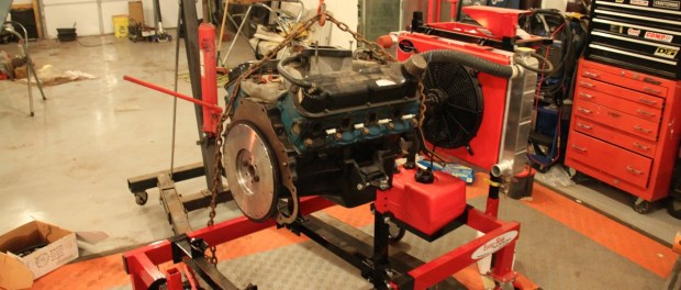 The engine was positioned over the stand with the hoist.