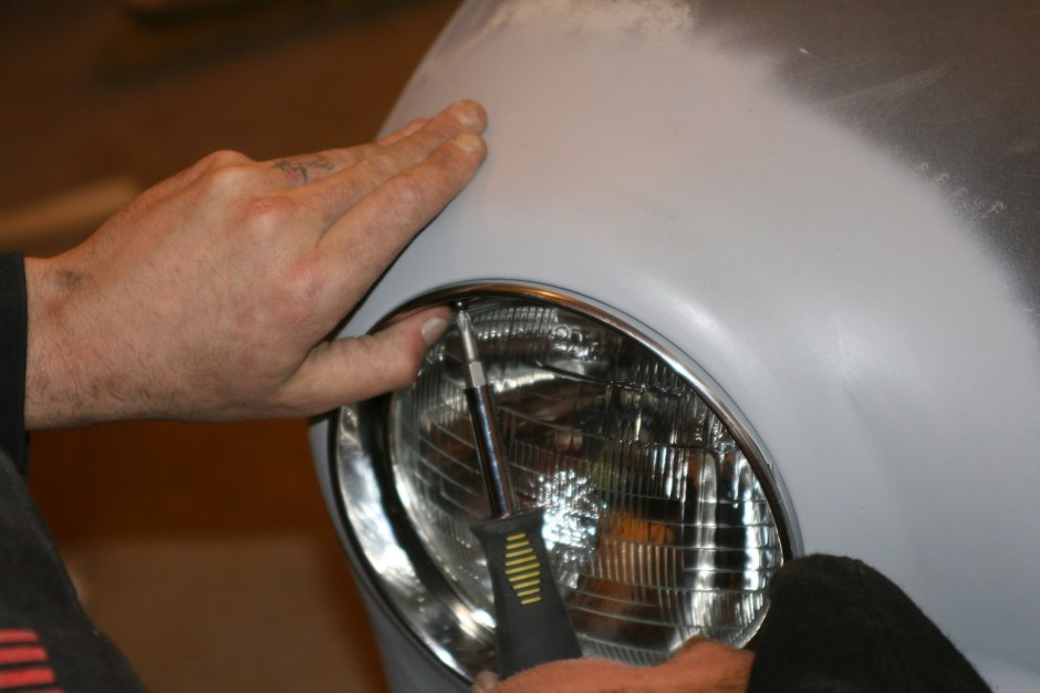 14. The headlamp was screwed in and the stainless steel trim bezel was mounted using two supplies stainless steel screws.
