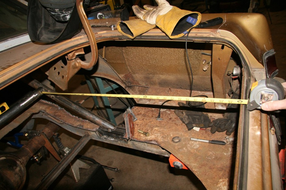 Before welding, the bar was squared to the body. Each side was measured to the inner edge of the trunk lip. Once set, the bar was welded in place.