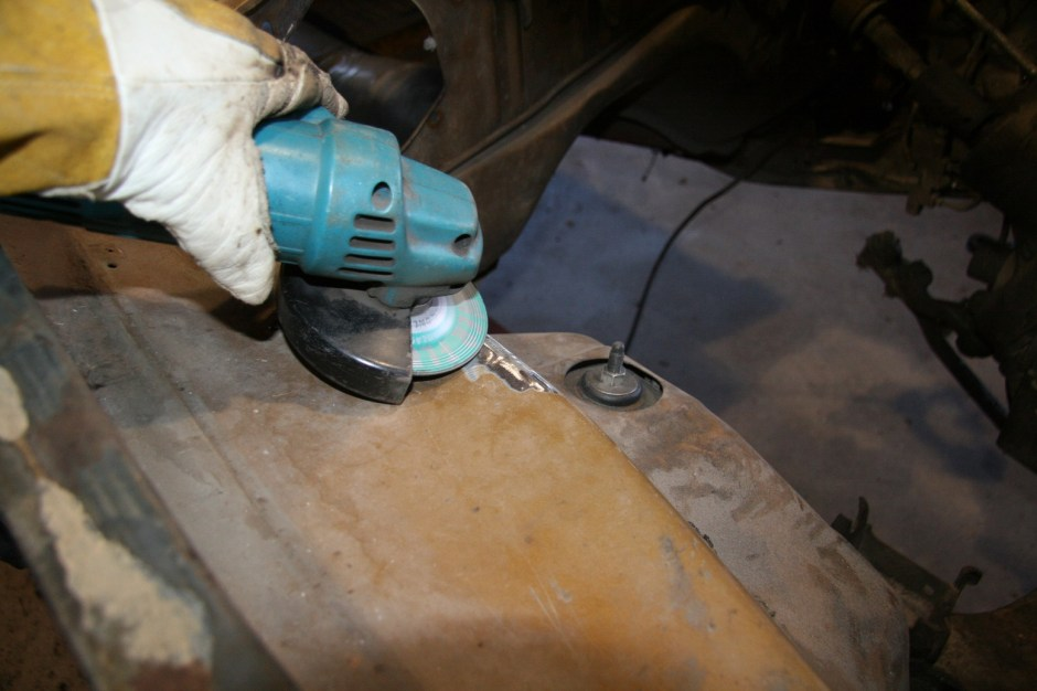 28. We prepped the fender by grinding the paint away. We also did this to the subframes and the firewall areas.