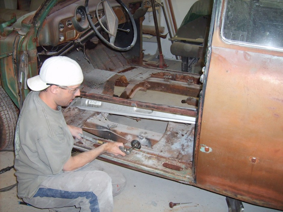 3. Jordan Lewis of Ramsey and Sons used a die-grinder to separate the rocker from what was left of the floor pan.