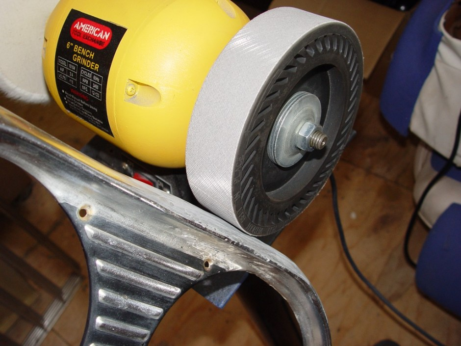 7. Once the panel has been smoothed out, an expander wheel, with a 1200 grit belt, is used to find the high and low spots. Easy pressure is the key to a good job here.
