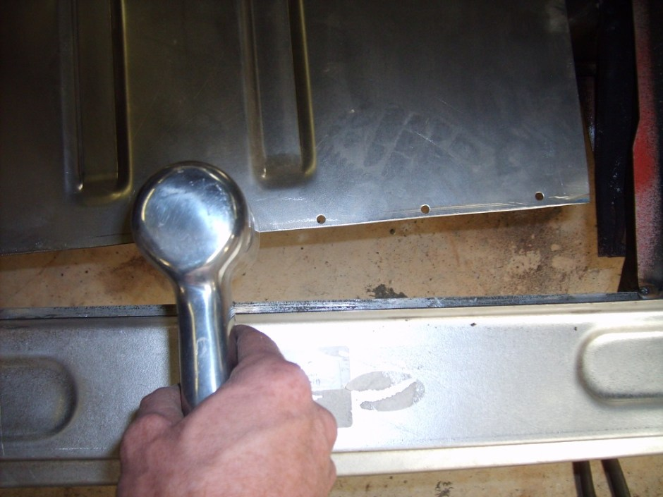 """11. Using a punch\flange tool, the floor pans were punched every 3-4"""" for new spot welds."""