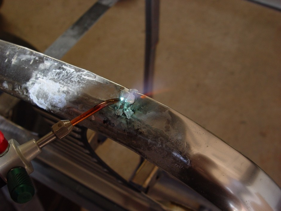 11. Once the metal has been added, heat the part so it can be smoothed.
