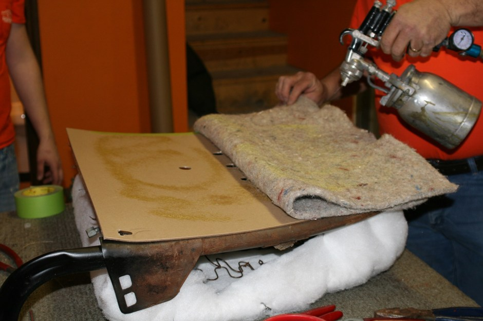 13. Gary sprayed a little upholstery adhesive on the cardboard and the jute and let it sit for a few minutes. If a spray gun and upholstery glue is not available, you can use 3M Super 77 aerosol.