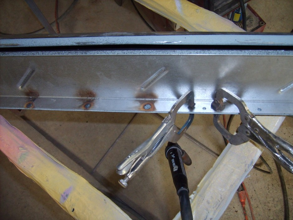 15. Then, with everything aligned, the inner and outer panels were clamped together and spot welded in place.