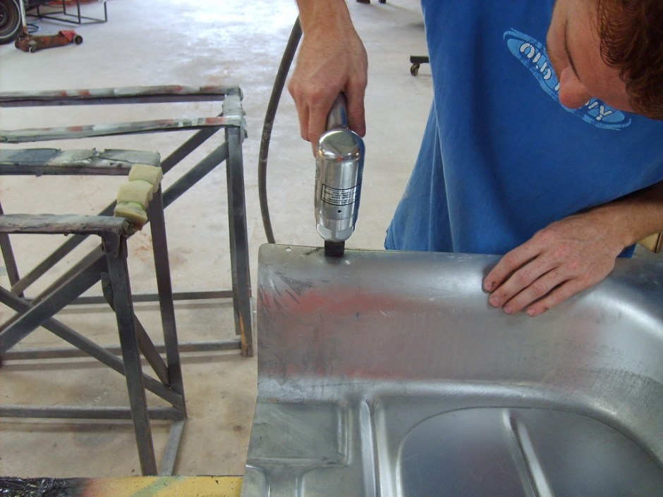 17. Toby also uses a punch\flange tool to punch holes for spot welds in the front section of the pan.