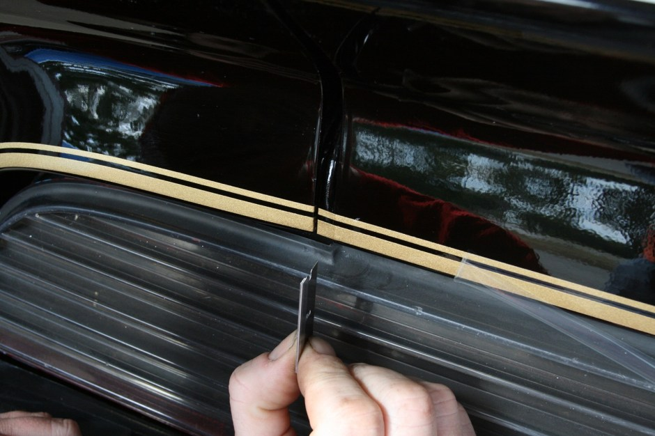 6. The taillight\trunk stripes were laid as one piece, then cut with a razor blade in the center.  The excess was then wrapped around the edge.