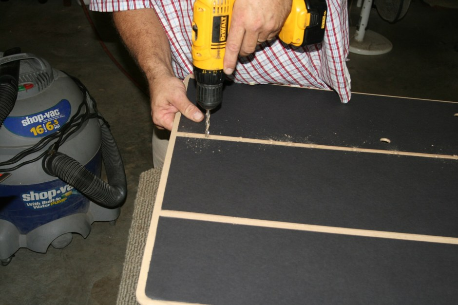 4. We drilled the cardboard for the trim pegs. A hole punch would have been better, but we left them at the shop.
