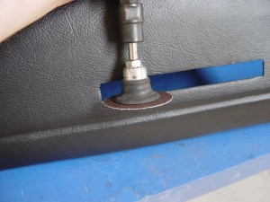 7. First, using a die-grinder and a 36-grit Roloc pad, the opening is trimmed out just slightly larger than needed. This is so it can be smoothed up later. Due to the shape of the dash, the grinding was done from the front side. Extreme care must be taken here, if any of the moving parts touch the rest of the cap, it will get pretty ugly and require even more repairs.