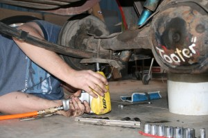 1.With the vehicle raised up and supported with jack stands, the driveshaft was removed and the U-bolts were removed. An impact-wrench is not required, but sure makes things easier.