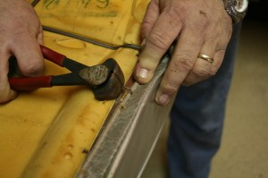 2.The old hog rings were snipped off with a pair of cutters. Once all of the rings are off, the cover slips right off.