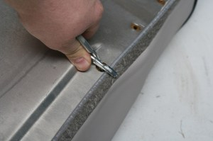 4.To begin the install, one side of the cover is attached to the frame. Only 2 or 3 rings are needed.