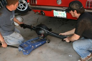 9.With the basic assembly completed, the 9-inch was slid under the car using the jack. The larger third-member is very heavy. This is definitely a 2-person job.