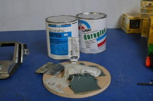 11.A mixture of Duraglass and body filler (about 1:1) was made up. This mixture yields the high strength and durability of Duraglass with the easy-to spread and sand characteristics of body filler.