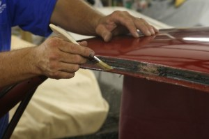 15.Using a chip brush, we brushed the cement on the windshield frame, at the top only.