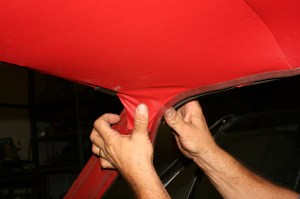 19.We stretched and glued the A-pillar corners down and replaced the windlace to keep it in place. Don't remove the welt clips until you are ready to install the windshield.