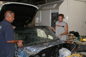 5.It takes 2 people to pull the glass off the car, we placed the glass on a parts stand covered in a blanket and set it in the back of the shop, so it wouldn't get broken.