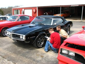05.An inspection is critical. It may not be a Mustang, but this Firebird is getting a final inspection before being loaded on the transport to its new customer.