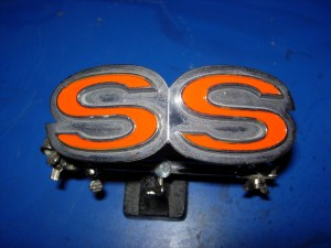 Here, the SS emblem has been painted with 1-Shot's Vermillion orange, with a 10% mix of reducer and hardener, for better adhesion and durability in the elements.