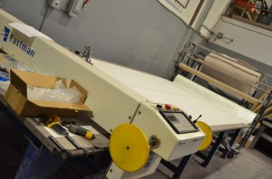 This Eastman cutting table makes it easy to create lots of patterns at one time. Large rolls of fiberglass await their turn under the knife.