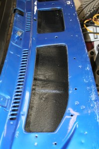 14.While we were at it, with everything taped off, we trimmed out the cowl interior section with some undercoating. This will protect the metal from rust, debris, and moisture which will certainly get in here and fester over time.
