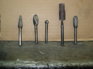 2.An assortment of fine carbide burrs assist in getting the most out your iron. Head porting kits can be purchased from most mail order parts warehouses and include all the tips and sanding rolls needed. Do not use coarse tips on cast iron.