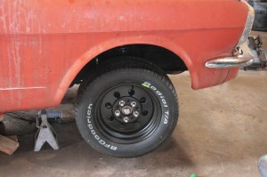 """17.Now the Mustang has 5-lug and disc brakes up front, but we are not done yet, the back end needs to come off the ground. All four wheels were wrapped in BF Goodrich Radial TA rubber, 15"""" out back and 14"""" up front, for that classic look with the black powder coat Cragar Street Lite wheel."""