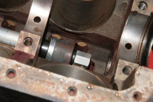 06.With the block on an engine stand and flipped upside down, I slid the bearing tool through cam bore. There is no specified order, but I start at the rear of the block, knock out the freeze plug, and then the bearing.