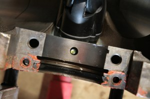 13.Using a flashlight shining into the cam bearing, you can see the alignment of the bearing to the main oiling hole. You need to check this on every bearing.