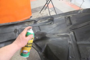 14.Then sprayed a couple of light coats of graphite spray onto the liner and let it dry. This can be done in the car or off the car.