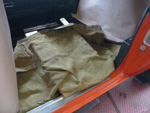 """Now in addition to the paper protection for the car's glass and remaining interior trim, a """"tent"""" has been fashioned from random 2-by-4 remnants and a welding blanket. Since the first cuts will be to the bottom side of the floor, this ounce of prevention makes for good fire insurance."""