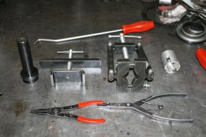 2.Transmission rebuilding requires specialized tools that are not found in your average toolbox. Shown here are just a few of the tools needed to work on the 4L60E. From the top, left to right- Cotter key pick, teflon shaft installer, rear clutch spring compressor, universal pump remover, electrical connection removal tool (a large socket will work, but usually breaks a tab), and 2 snap ring pliers.