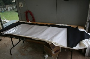 02.Inside the shop, the rear curtain was laid out on the assembly table. Some curtains have zippers, so the correct orientation is important.