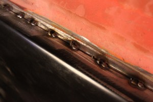 21.The long stretches of flat panel make warping a real problem. Stitch welding will help. By welding small spot welds, every few inches, the heat is spread out, allowing the panel to cool faster, reducing warpage. This picture shows the second round of spot welds.