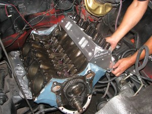 12.This shot shows the headers in place before the heads went on the motor. The headers fit the car, but gave us a little trouble, more on that in next article.