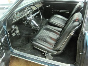 03.The front seats and carpet look great. The stock buckets were recovered with new upholstery, but the console, gauges and the rest of the interior is original.