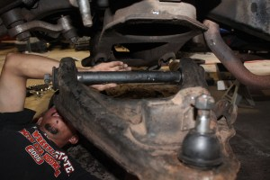 14.The lower arm was reinstalled in the truck, with the shaft located on the pins.