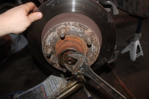 20.Here is a quick tip—the proper method of seating wheel bearings is to rotate the rotor back and forth while slowly tightening the nut until there is drag on the bearings. Then you back it off a touch and set it with the cotter pin.