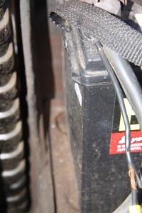 8. This side of this battery is bulging, which is a sign that it has frozen up. That does not mean it won't function, but it won't last as long as it could have. If it froze hard enough, it is possible that the plates inside have shorted, which would mean the battery is toast.
