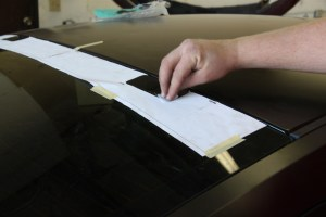 19.The window louvers came with a paper guide that gets taped to the rear window. The initial position is based of measuring to the center of the rear window. We wiped the glass in the hinge-mount area with alcohol, then adhesion promoter.